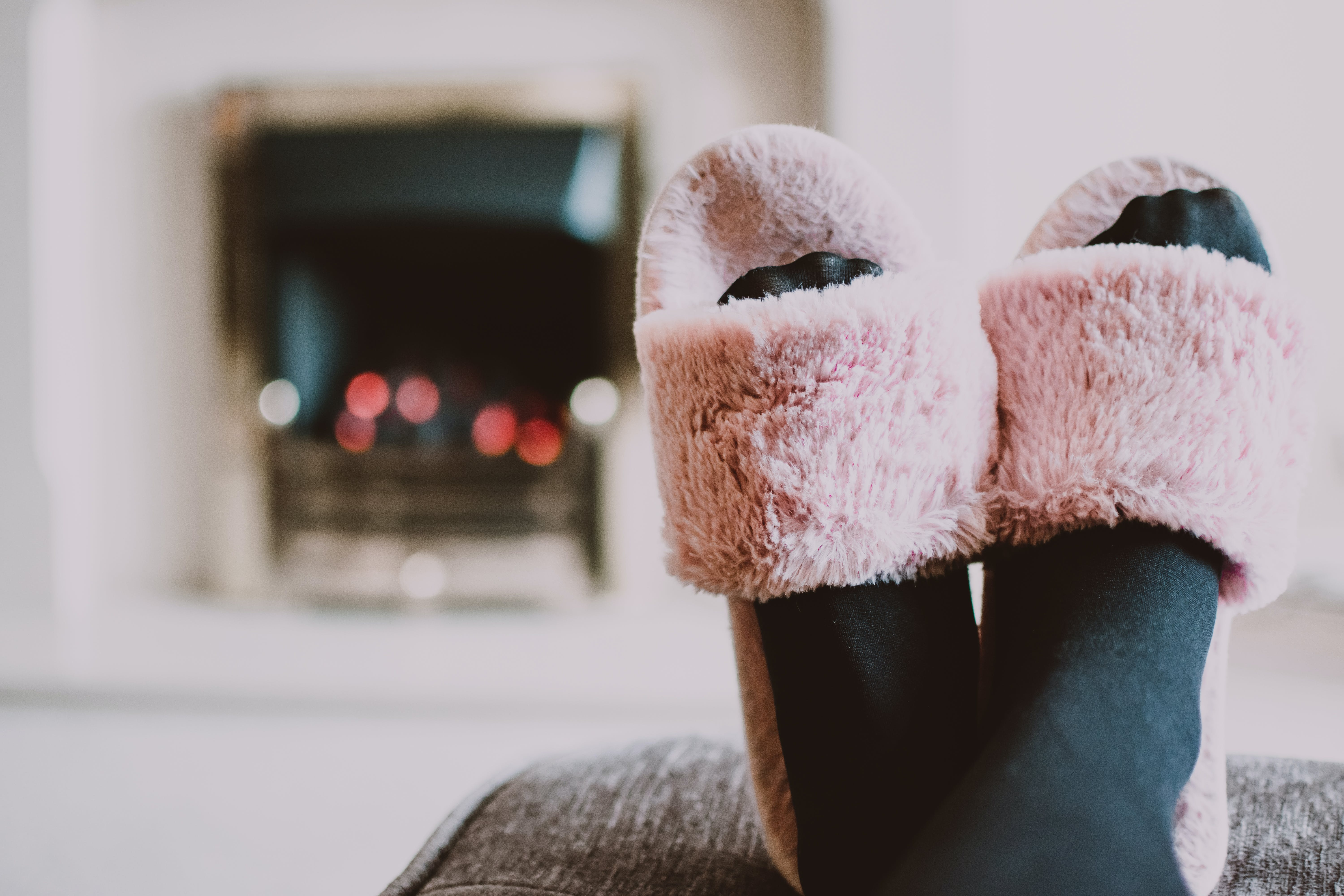 Close-up Photography of Person Wearing Pink House Slippers