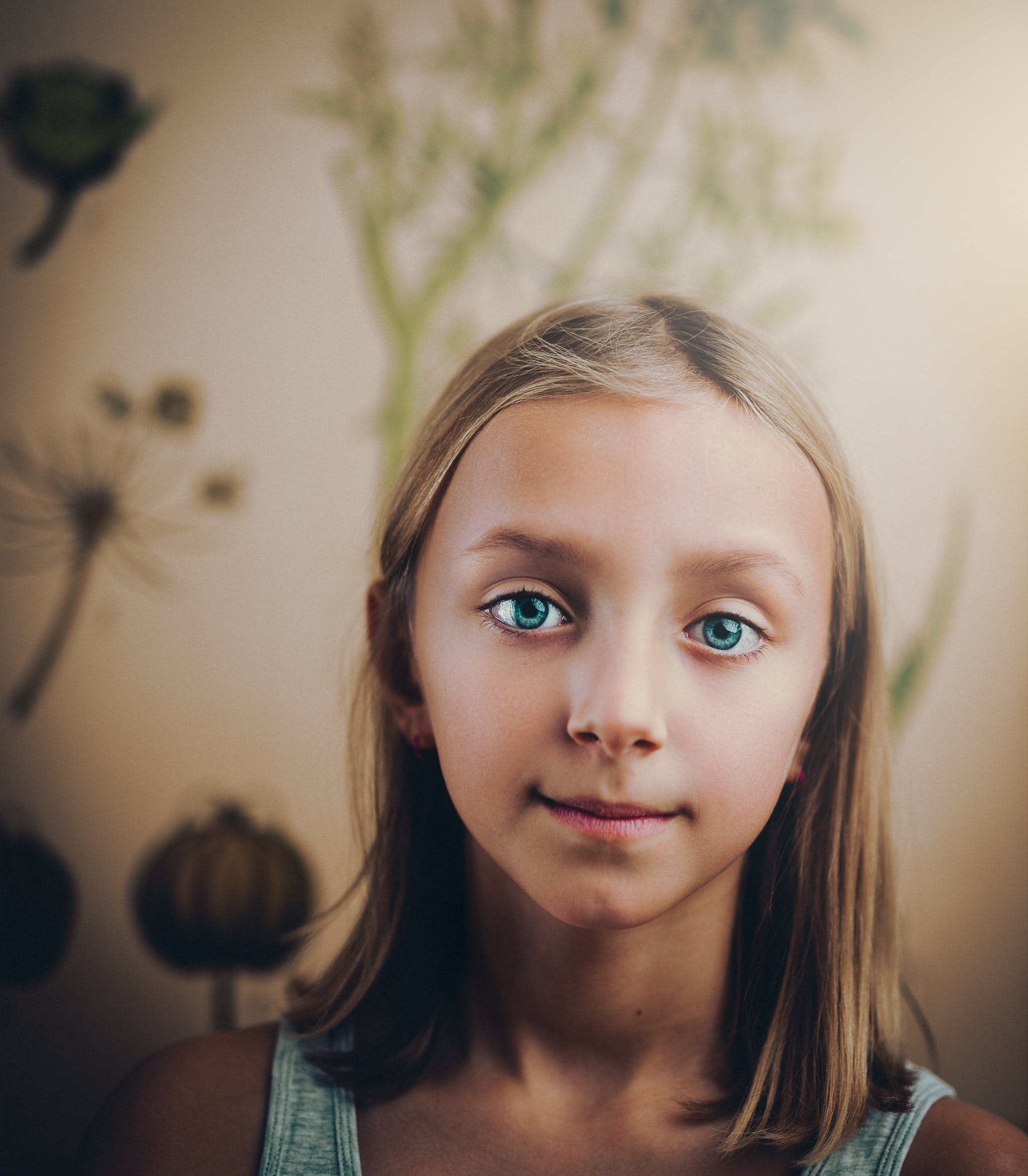 Smiling Girl Standing in White Painted Wall Room